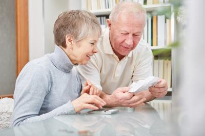 elderly couple calculating finances