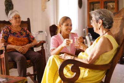 Caregiver assisitng elderly woman