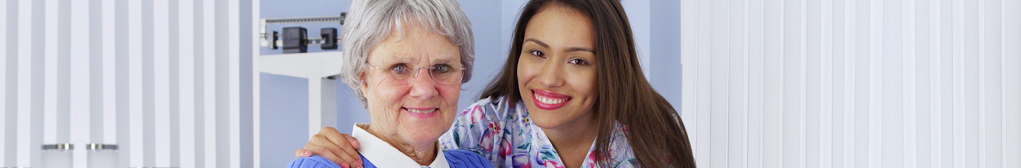Happy senior woman with friendly Mexican caregiver