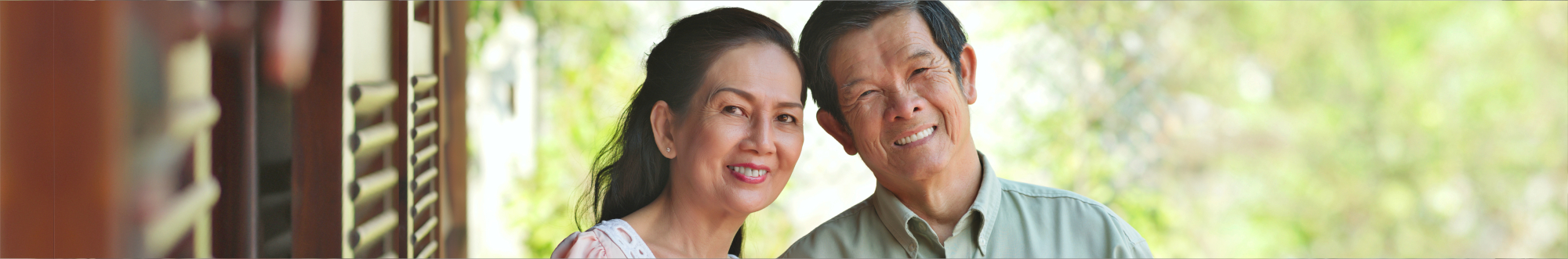 Portrait of Vietnamese retired couple smiling and looking at the camera